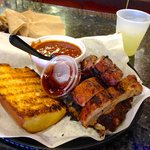 Pork ribs, bread, beans and daiquiri