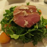 Smoked duck breast with arugula, melon and goat cheese
