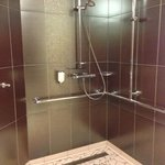 The unenclosed shower in Rm 114