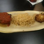 Char-crusted and blackened salmon, sauce Orleans dirty rice and fried green tomatoes
