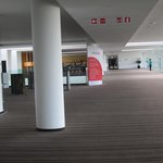 a long walk span from the elevator foyer to room area