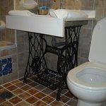 washroom - sink built on old singer sewing machine