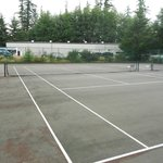 tennis court with view of storage facility