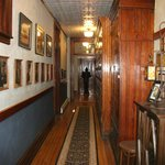 A hall to another room, original firemen's lockers on the right hand side.