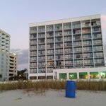front of holiday sands on the beach