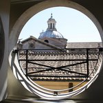 port hole window over rooftops