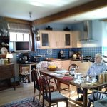 The homely farmhouse kitchen where breakfast is cooked and served.