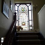 The beautiful window and staircase that led to our room.