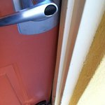 showing the door is locked but that you can push it in a few inches. think your safe behind this