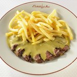 Our legendary steak-frites topped with our 21-ingredient sauce.