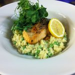 Salmon on a pea and mustard risotto