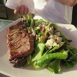 Good salad, but steak undercooked