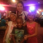 Cindy, our waitress taking pictures with her clientele's children :)