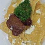 Spinach and ricotta ravioli in sweet potato sauce