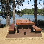 Picnic area overlooks lake.