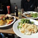 Three plates of tasty food.