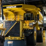 Visit the theater in the bed of the Cat 797 Mining Truck!