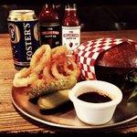 Mesquite smoked cheeseburger, gunpowder onion rings, house pickle, bourbon bbq sauce