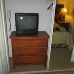 The TV and dresser in the 2nd bedroom closet