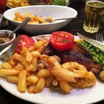 Sirloin steak, chips, peas, tomatoes, mushrooms and onion rings