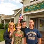 Family in front of Yellowstone Basin Inn