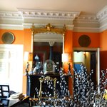 Front Parlor with Orange Walls and Lovely Mouldings