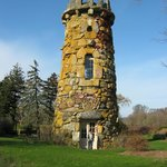 an interesting tower on the property nestled in an area of homes