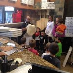 kids learning how to make pizza with Mr. G