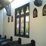 Small and inviting with beautiful stained glass windows.