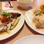 Ayam Percik Kelantan (broiled chicken dressed in sweet coconut gravy)and Chicken Rice