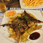 Roasted Quail with potatoes.