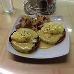 Bagel Benedict with a side of potatoes.