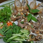 Rice noodle with fresh horapa, salad, Vietnamese springroll and stir fried tender beef