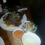 King Henry Rack of Ribs braised in a sticky honey,beer & chilli sauce served with sweet potato m