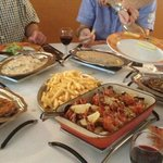Different styles of steak and the gambas in the centre