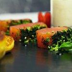 Herb marinated salmon fillet stracciatella de buratta and home made blinis
