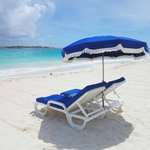 Groomed sand, clean chaise lounges