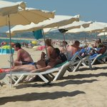 Fairly busy on the beach, umbrella and two sunbeds were 10 Euros per day