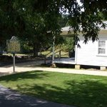 A view of the Elvis Presley Birthplace from the walkway leading up to it