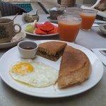 Asian crispy pancakes and fresh fruit for breakfast