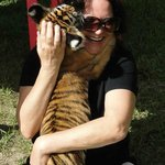 Yours truly with tiger cub (at Single Vision, Melrose, Fla)