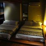 Bedroom with 3 queen size bed on the upper floor of the suite