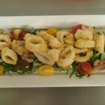 Calamari Fritti with grilled jalapeno aoli, citrus dressing, marinated heirloom tomatoes.