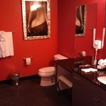 Very RED bathroom. Needs better lighting and a paint job!