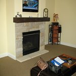 Gas fireplace and corner cabinet with games and books