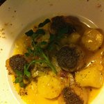Grilled scallops with leeks fondu & black truffle jus
