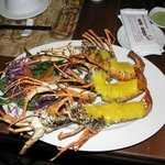 Baked lobsters with garlic butter sauce