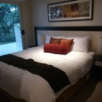 King size bed in 1 bedroom suite, ground floor room 17 overlooking courtyard