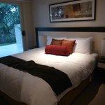 King size bed in 1 bedroom suite, ground floor room 17 overlooking courtyard