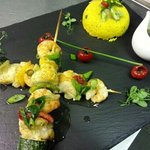 Monkfish and king prawns kebabs with golden savoury rice and ginger & spring onion sauce
